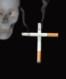 Smoking of cigarettes and death. Royalty Free Stock Photos