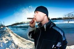 Smoking cigars Royalty Free Stock Photo