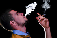 Smoking cigars Royalty Free Stock Images