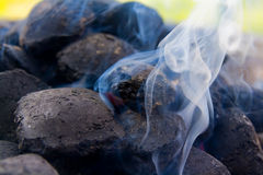 Smoking coal. Heap of smoking pieces of coal stock photography