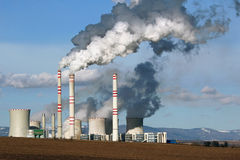 Smoking coal power plant Stock Images