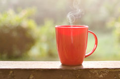 Smoking Coffee in a mug. Coffee mug with smoke in natural outdoor Stock Images