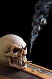 Smoking on a coffin Royalty Free Stock Photos
