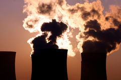 Smoking cooling towers Stock Images