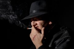 Smoking in the dark Royalty Free Stock Photography