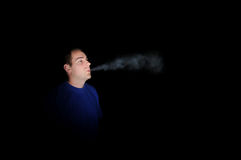 Smoking in the Darkness Royalty Free Stock Photo
