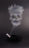 Smoking is a death. Concept of harmful habit Stock Photos