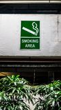 Smoking designated area sign. Mounted on the wall in the open space Royalty Free Stock Photo