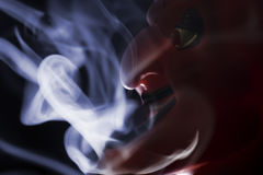 Smoking devil Royalty Free Stock Photography