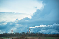 Smoking distant factory chimneys Stock Images