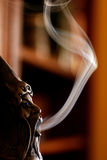 Smoking Doll. Close up view of a smoking doll with smoke Stock Photo