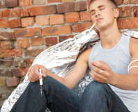 Smoking drug addict young man in action Royalty Free Stock Photo