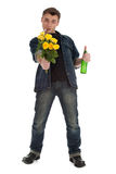 Smoking drunk young man holding yellow roses Royalty Free Stock Images