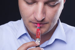 Smoking electric cigarettes Stock Image