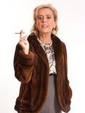 Smoking elegant senior lady Royalty Free Stock Image