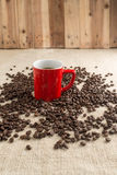 Smoking Espresso in red cup with coffee beans and old coffee mil Royalty Free Stock Photos