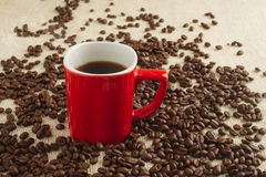 Smoking Espresso in red cup with coffee beans and old coffee mil Royalty Free Stock Photography
