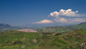 Smoking Etna as seen from Petralia Soprana Stock Images