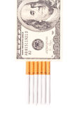 Smoking Expense. Cigarettes and a Fake Hundred Dollar Bill Royalty Free Stock Photography