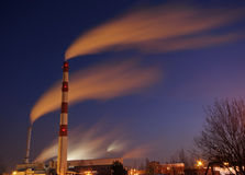 Smoking factory at night Stock Photography