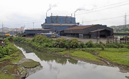 Smoking factory in outskirt of Santander city Stock Images