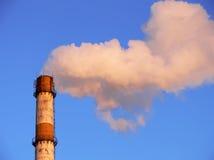 Smoking factory pipe closeup. Factory pipe smoking with a white smoke over the blue sky closeup Stock Photos