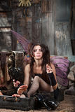 Smoking Fairy in Suitcase Royalty Free Stock Images