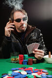 Smoking gambler Royalty Free Stock Photography
