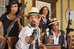 Smoking Gangster with Whiskey and Guns Royalty Free Stock Images