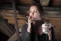 Smoking on the garret Stock Photos