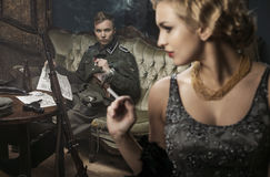 Smoking german soldier with his lovely wife Royalty Free Stock Photos