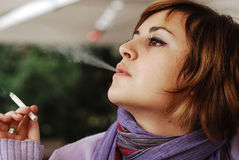 Smoking girl Stock Photos