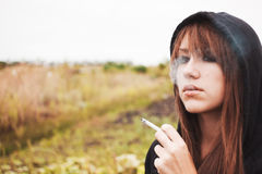 Smoking girl with cigarette Royalty Free Stock Photos