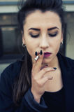 Smoking girl portrait Royalty Free Stock Photography
