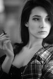 Smoking girl Stock Images