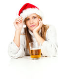 Smoking girl in red Santa hat drinking beer Royalty Free Stock Photography