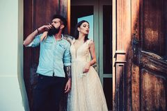 Smoking grew into a habit with him. Bearded man smoke outdoor. Couple in love have smoking break. Romantic couple of royalty free stock photography