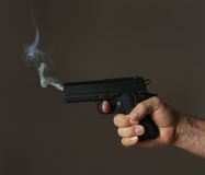 Smoking gun Stock Photos
