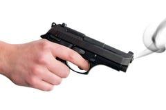 Smoking Gun. Hand holding smoking gun. Isolated on white background Royalty Free Stock Images