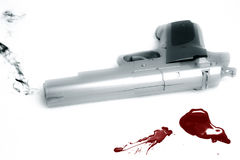 Smoking gun and blood splatter Stock Photos