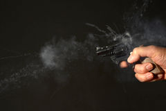 Smoking Gun in hand Royalty Free Stock Images