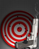 Smoking gun with target Royalty Free Stock Images