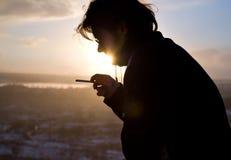 Smoking guy in sunlight Royalty Free Stock Image