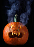 Smoking Halloween pumpkin head Stock Photography