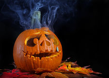 Smoking halloween pumpkin head Royalty Free Stock Photo