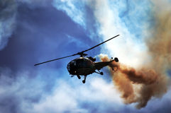 Smoking helicopter Stock Photo