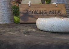 Smoking here sign wooden wood tobacco public concept Royalty Free Stock Photography