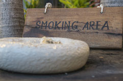 Smoking here sign wooden wood tobacco public concept Royalty Free Stock Images