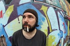 Smoking homeless man Royalty Free Stock Photos