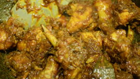 Smoking hot chicken curry being made stock video